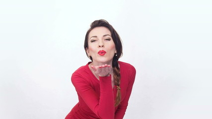 lady in red sending an air kiss