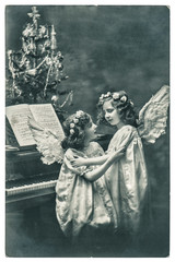 lovely angels with white wings and christmas tree