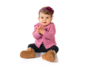 Baby clapping over white background
