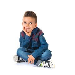 Kid thinking over white background