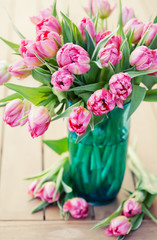 Bouquet of beautiful pink tulips in vase