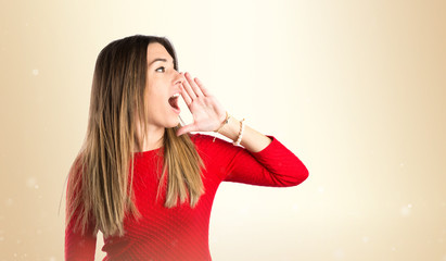 Young girl shouting over isolated white background