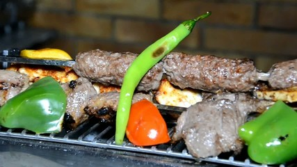 Oriental kebab meat on hot plate