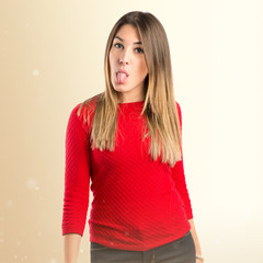 Young girl doing a joke over isolated white background