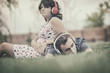 Boy and girl  listening to music on headphones