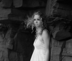 Beautiful woman in a white dress. Black and white portrait.