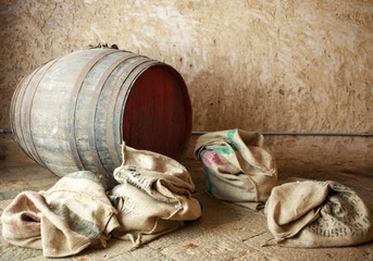 Old barrel with burlap sacks.