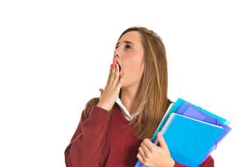 Student yawning over isolated white background