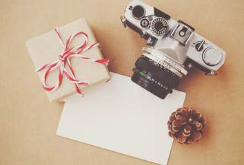 Handmade gift box and film camera on blank card with retro filte