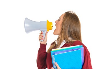 Student shouting by megaphone over white background