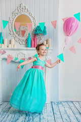Beautiful little girl in a blue dress