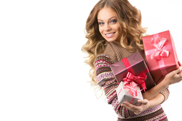 Portrait of a young happy girl with gift box in hands.