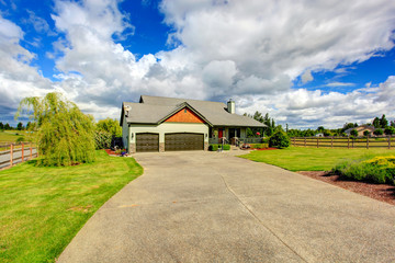 Countryside house exterior with garage and driveway