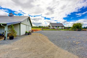 Horse farm land with barn.