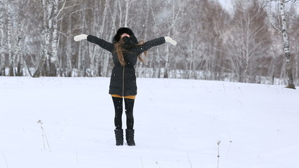 Beautiful smiling girl outdoors in winter