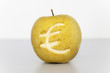 euro symbol engraved in a yellow apple