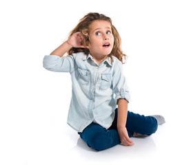 Blonde little girl listening something