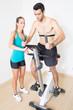 canvas print picture - Herzfrequenz messen im Fitnesstudio mit Coach