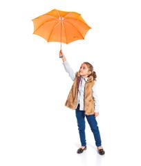 Blonde little girl holding an umbrella
