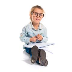 Little girl with glasses studing