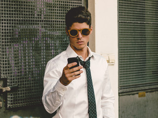 Casual businessman looking his smartphone