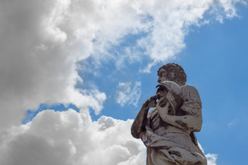 Statue and clouds