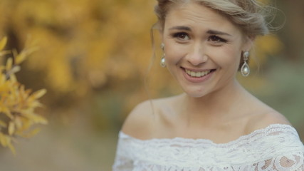 Charming blonde bride smiling and laughing