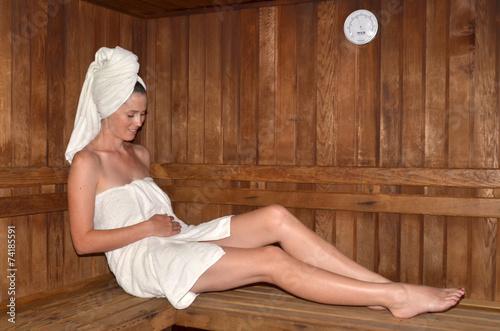 Leinwanddruck Bild Pregnant woman relaxing in Sauna