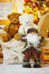 Santa and teddy bears under the decorated Christmas tree