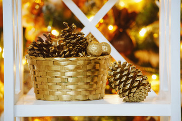 Decoration still life with fir cones and golden basket