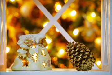 Decoration details in golden light from Christmas tree