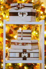 Decorated gift boxes under bright lighting Christams tree