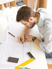 Young architects working at office