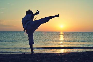 Young boy in karate uniform