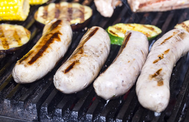 cooking sausages on the grill in the restaurant