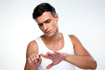 Man doing manicure over gray background