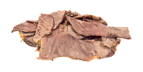 Leftover chuck roast sliced thin on a white background