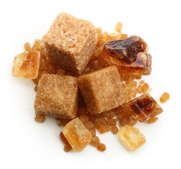 Brown cane sugar cubes and caramelized sugar