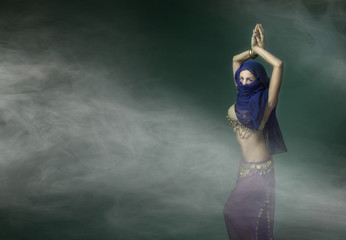 belly dancer in a cloud of fog