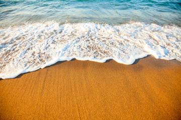 Wave on sandy beach