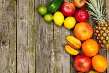 Set of colorful fruits on old wood background