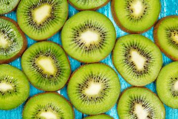 Kiwi slices on blue wood background