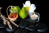 Fototapety Aromatic spa concept of bottles essential oil, bergamot fruits,