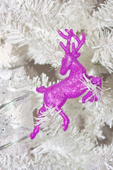 Christmas tree decorated with toys pink deer