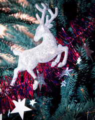 Christmas tree decorated with toys deer