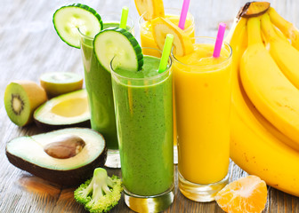 Green and yellow smoothie with fruits and vegetables