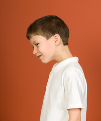 boy portrait in white shirt on brown