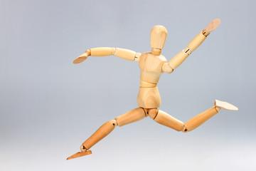 Wooden mannequin jumping