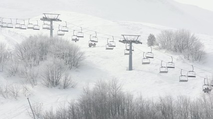 Chair lift in winter mountain landscape