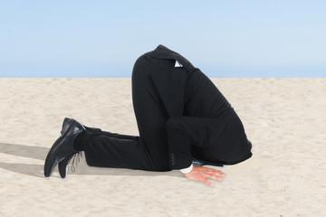 Businessman Hiding His Head In Sand